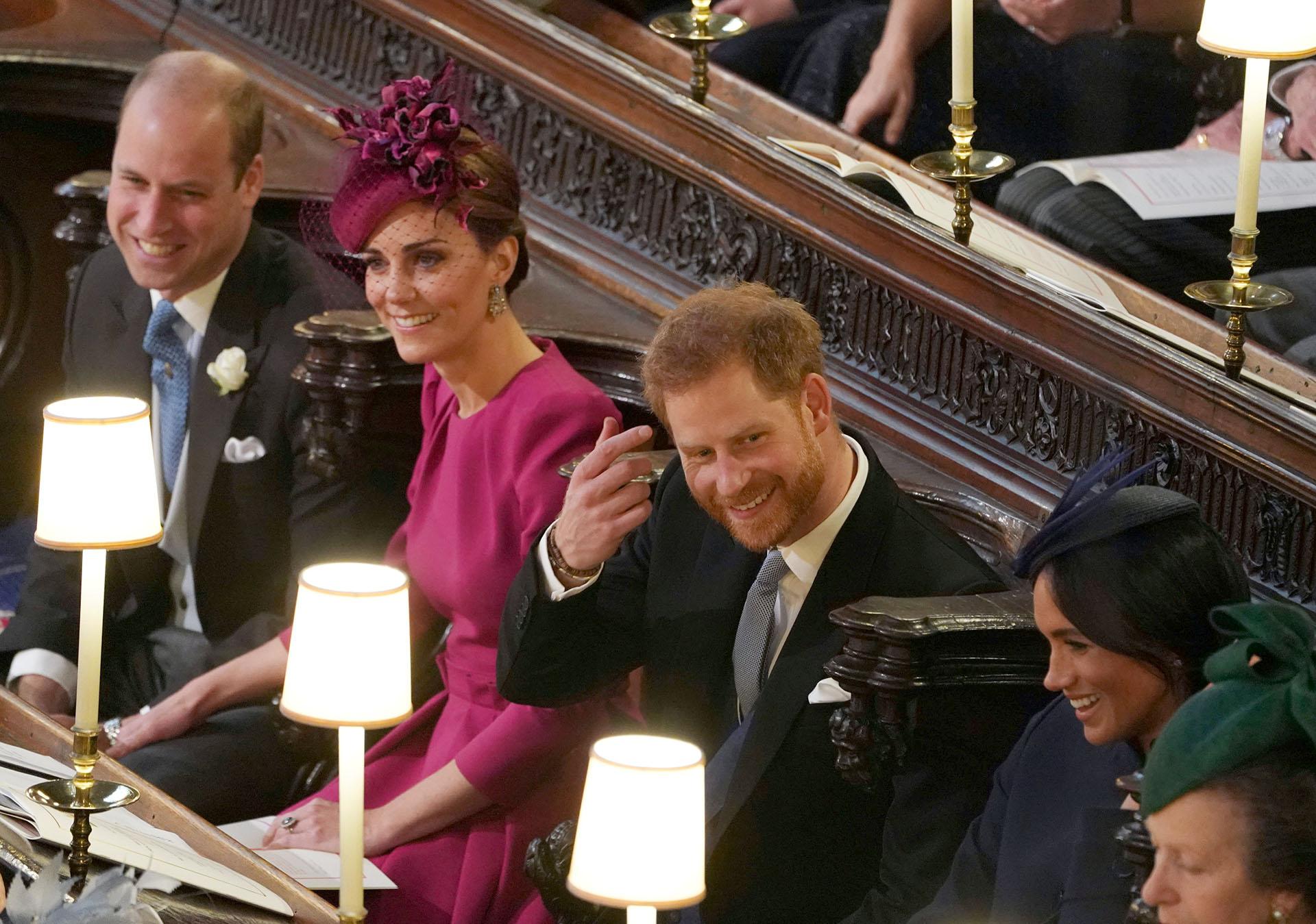 Willim y Harry con Kate Middleton y Meghan Markle en el casamiento de la princesaEugenie