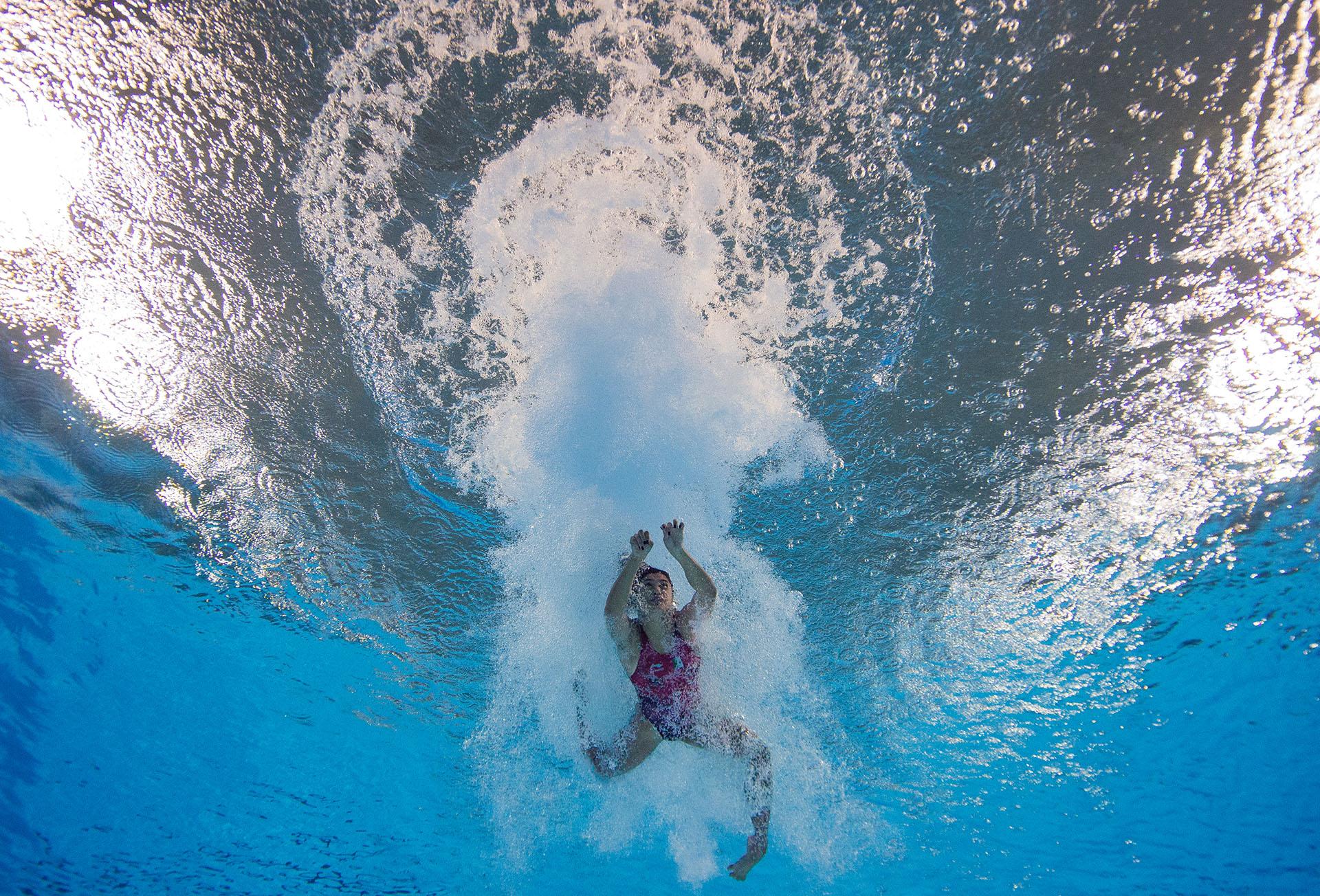 Brillante captura de la nadadora mexicana Gabriela Belem Agundes Garcia, antes de las preliminares de Buceo Femenino en el natatorio del Parque Olímpico de los Juegos de la Juventud 2018 celebrados en Buenos Aires (AFP)