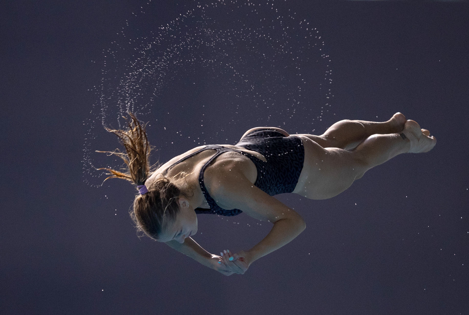 La ucraniana Sofiia Lyskun compitiendo en la preliminar de Trampolín para mujeresen el Natatorio Parque Olímpico de Buenos Aires(AFP)