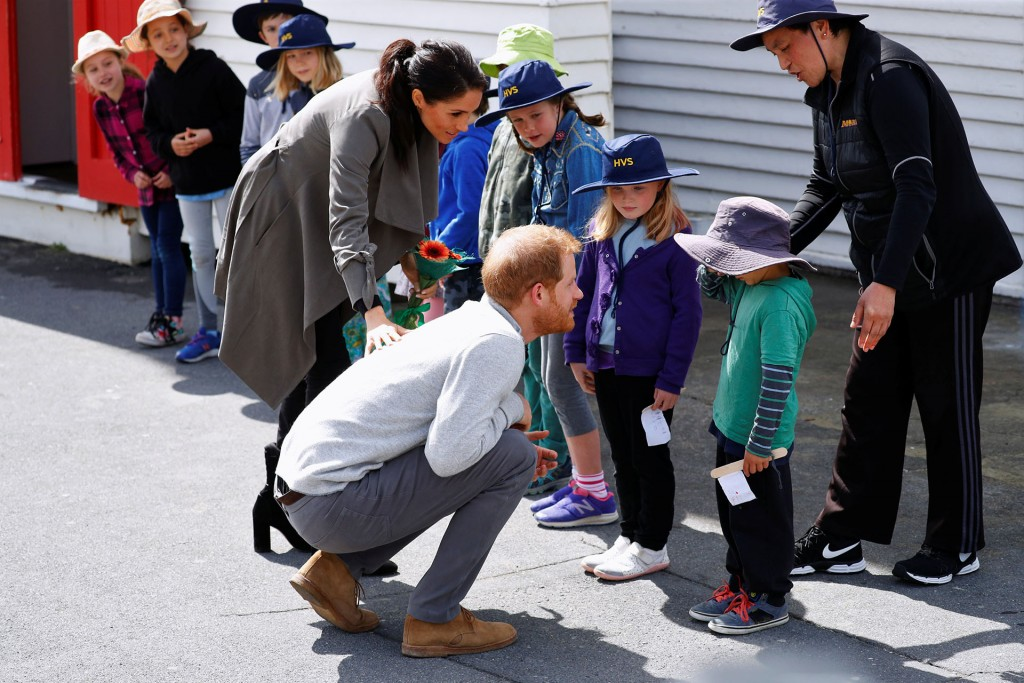 Britain's Prince Harry and Meghan, the Duchess of Sussex talk to Joe Young (in green jumper) as they meet with children outside a cafe, in Wellington, New Zealand October 29, 2018. REUTERS/Phil Noble
