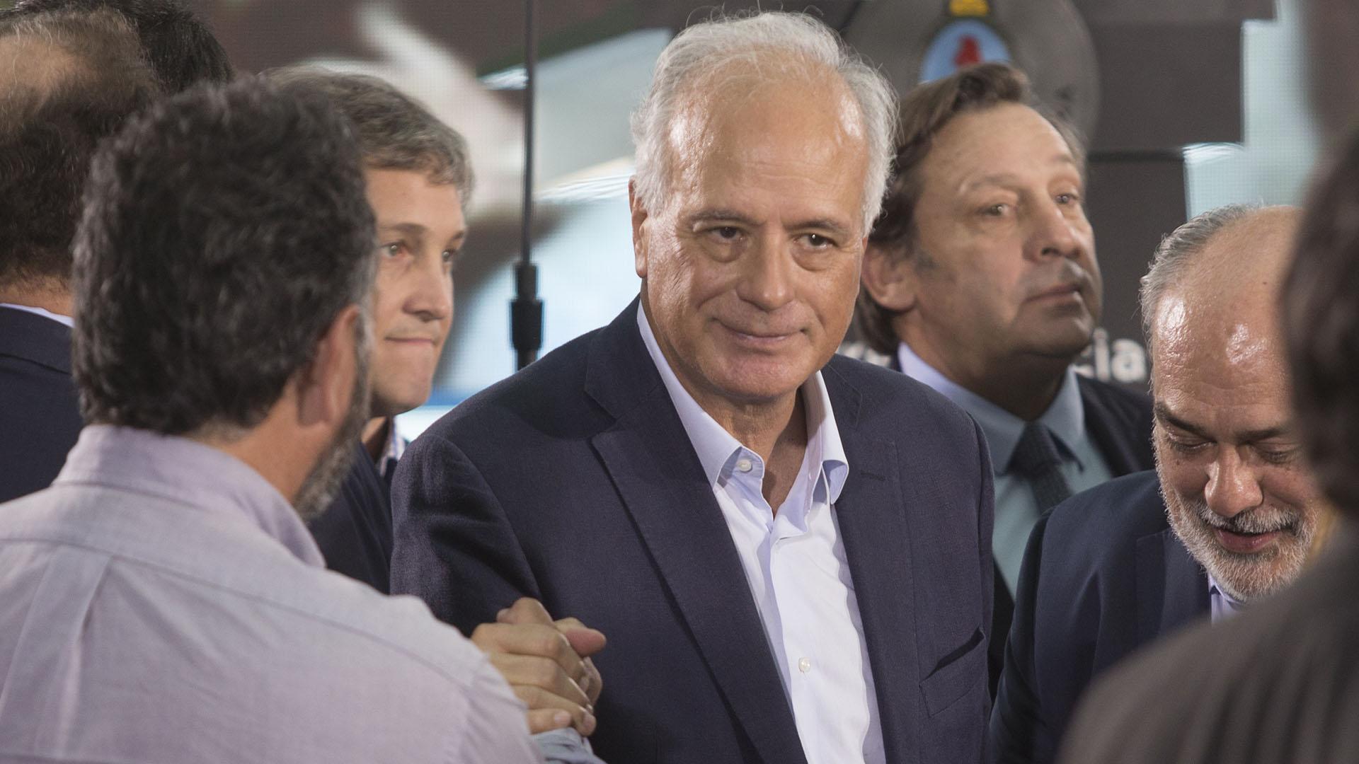 El dirigente radical Enrique Nosigliajunto a los funcionarios Fernando De Andreis y José Torello