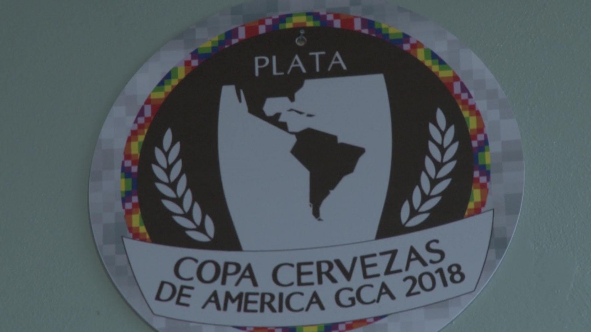 Una de las medallas ganadas por la cervecería en la Copa América de este año