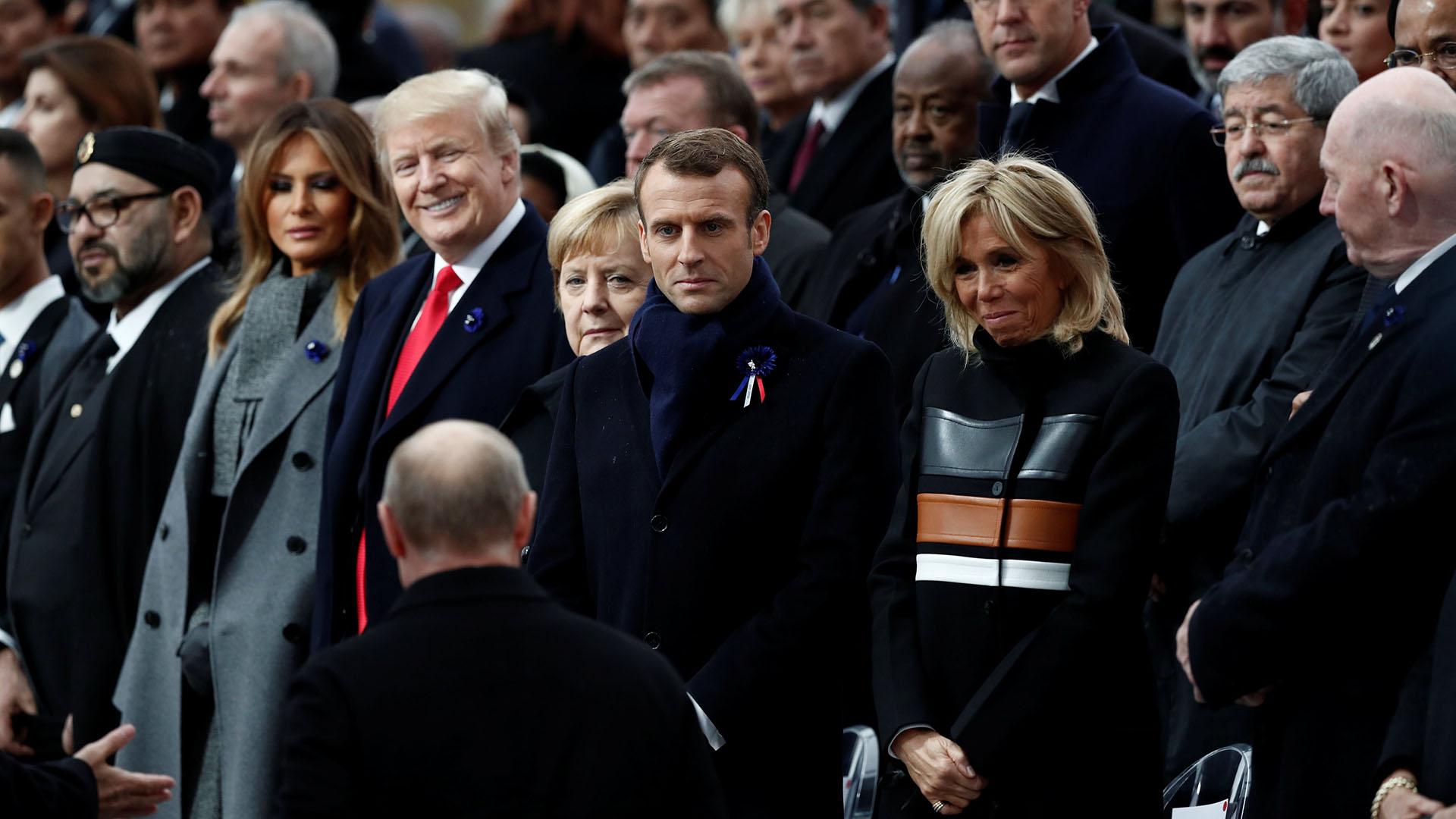 El presidente ruso Vladimir Putin, de espaldas, fue el último en llegar