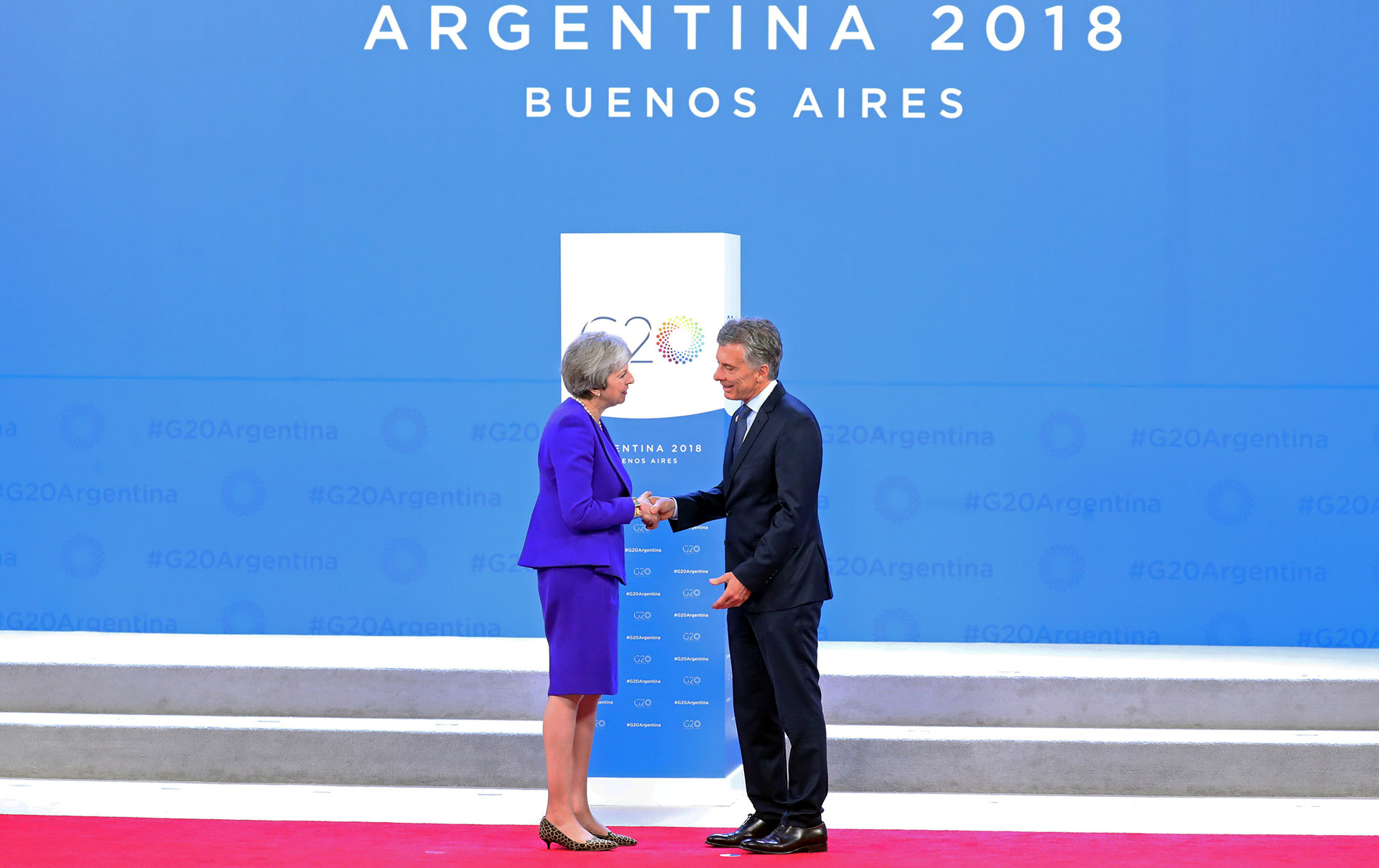 Theresa May y Macri