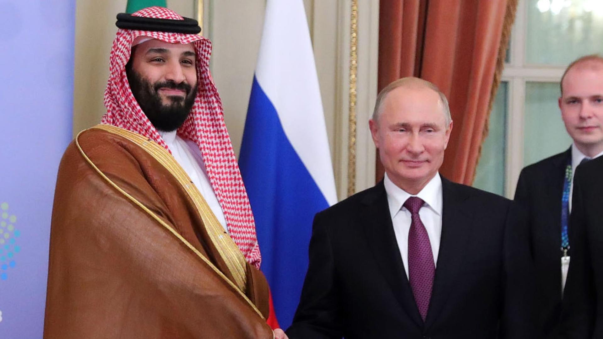 el príncipe saudito y el líder ruso, cruzaron saludos y miradas cómplices en el G20(AFP)