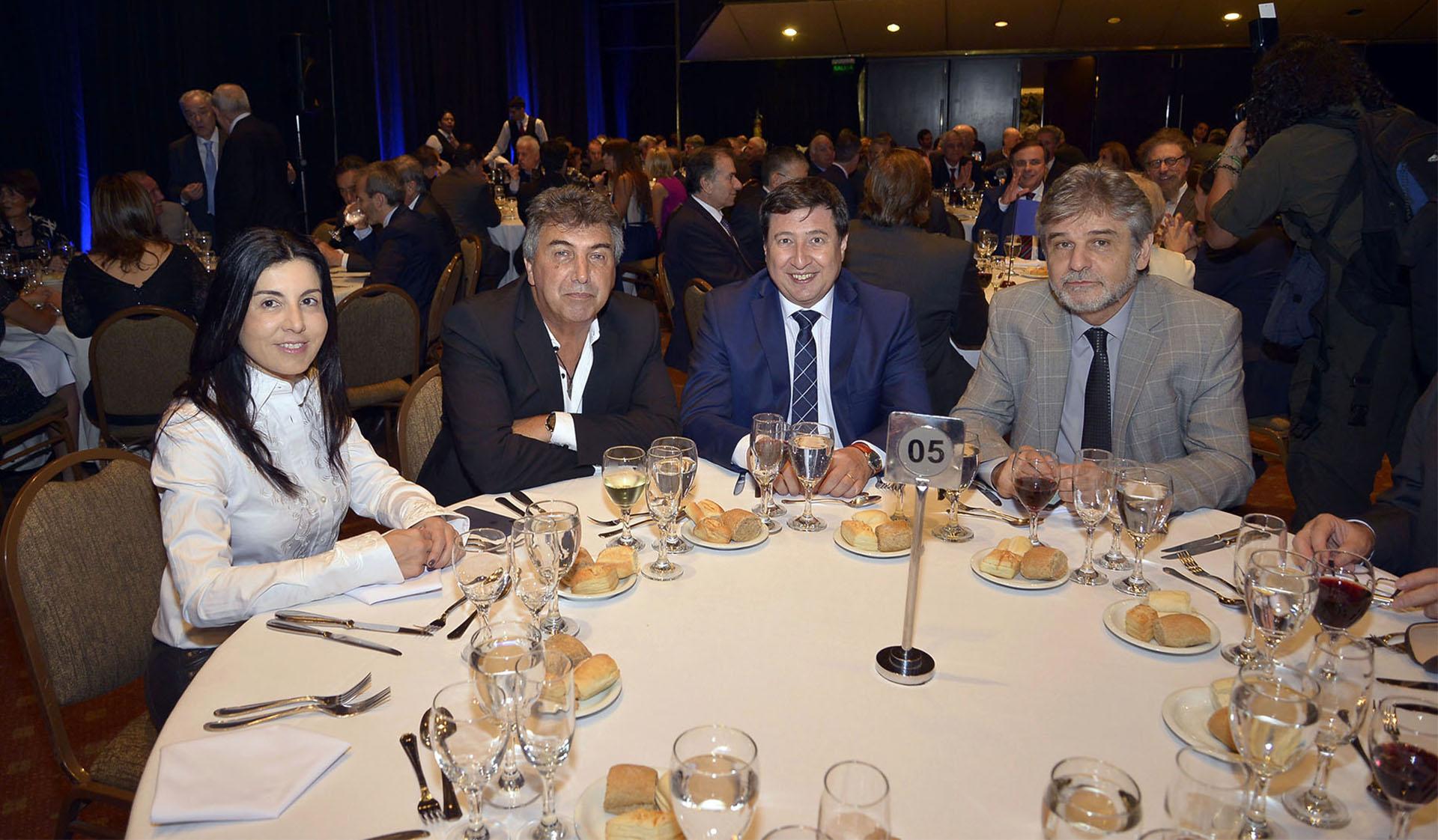 El director del Enacom, Claudio Ambrosini; y los diputados Daniel Arroyo y Daniel Filmus