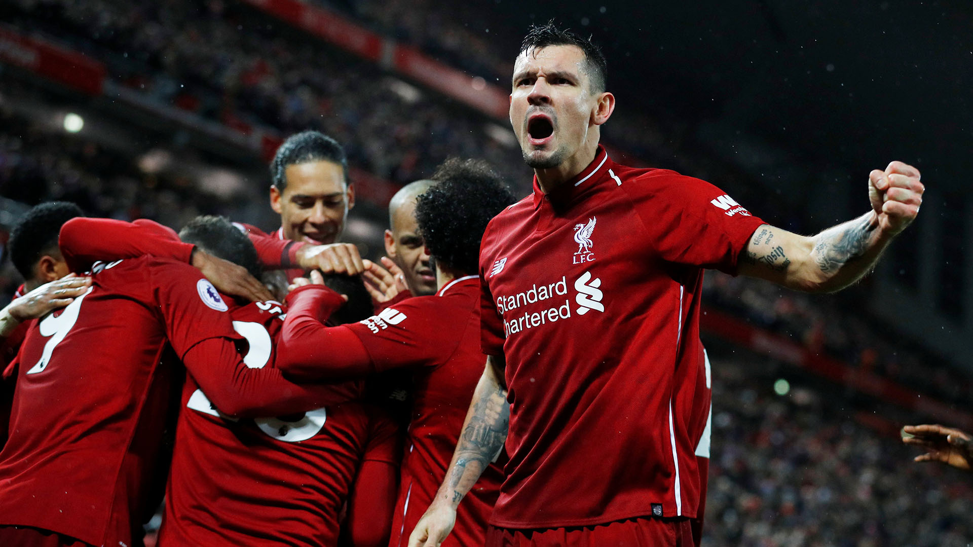 """Soccer Football – Premier League – Liverpool v Manchester United – Anfield, Liverpool, Britain – December 16, 2018  Liverpool's Xherdan Shaqiri celebrates scoring their third goal with Dejan Lovren and team mates  REUTERS/Phil Noble  EDITORIAL USE ONLY. No use with unauthorized audio, video, data, fixture lists, club/league logos or """"live"""" services. Online in-match use limited to 75 images, no video emulation. No use in betting, games or single club/league/player publications.  Please contact your account representative for further details."""