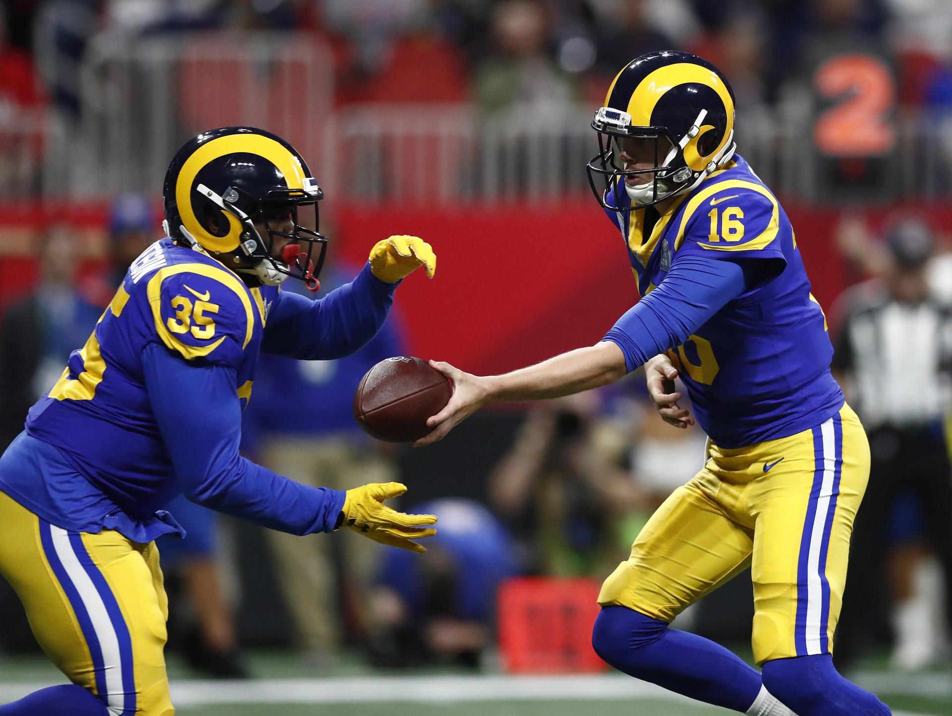 Jare Goff y C.J. Anderson de Los Angeles Rams.