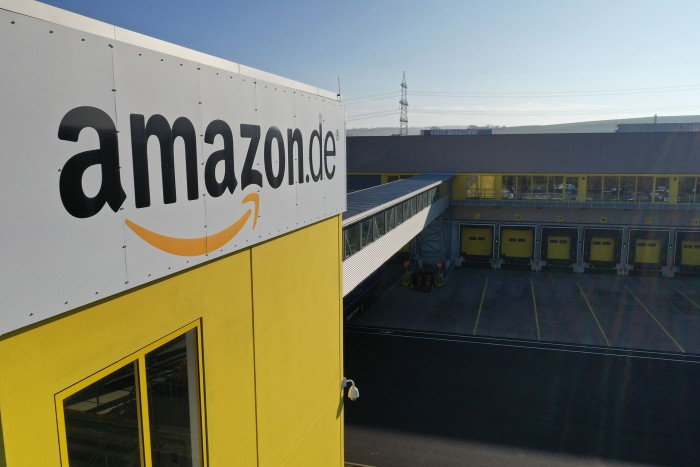 An Amazon.com Inc. logo sits on the exterior of the company's fulfilment center in Koblenz, Germany, on Friday, Nov. 23, 2018. Germans are expected to buy about 2.4 billion euros worth of goods on Black Friday and Cyber Monday, an increase of about 15 percent over last year. Photographer: Alex Kraus/Bloomberg