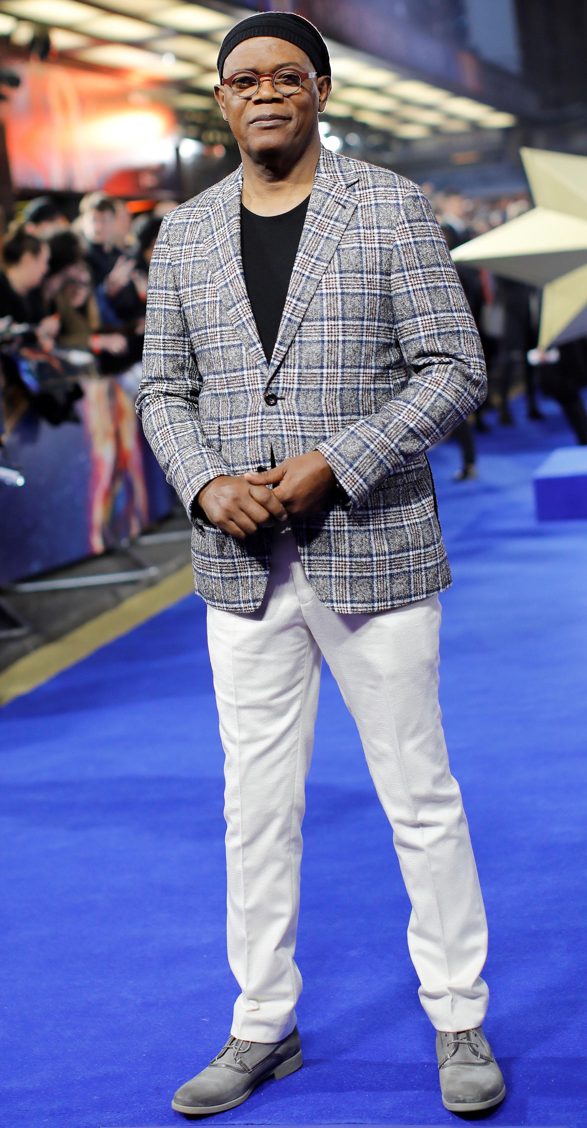 Samuel L. Jackson, también lució pantalones blancos y lo completó con un clásico saco de tartán