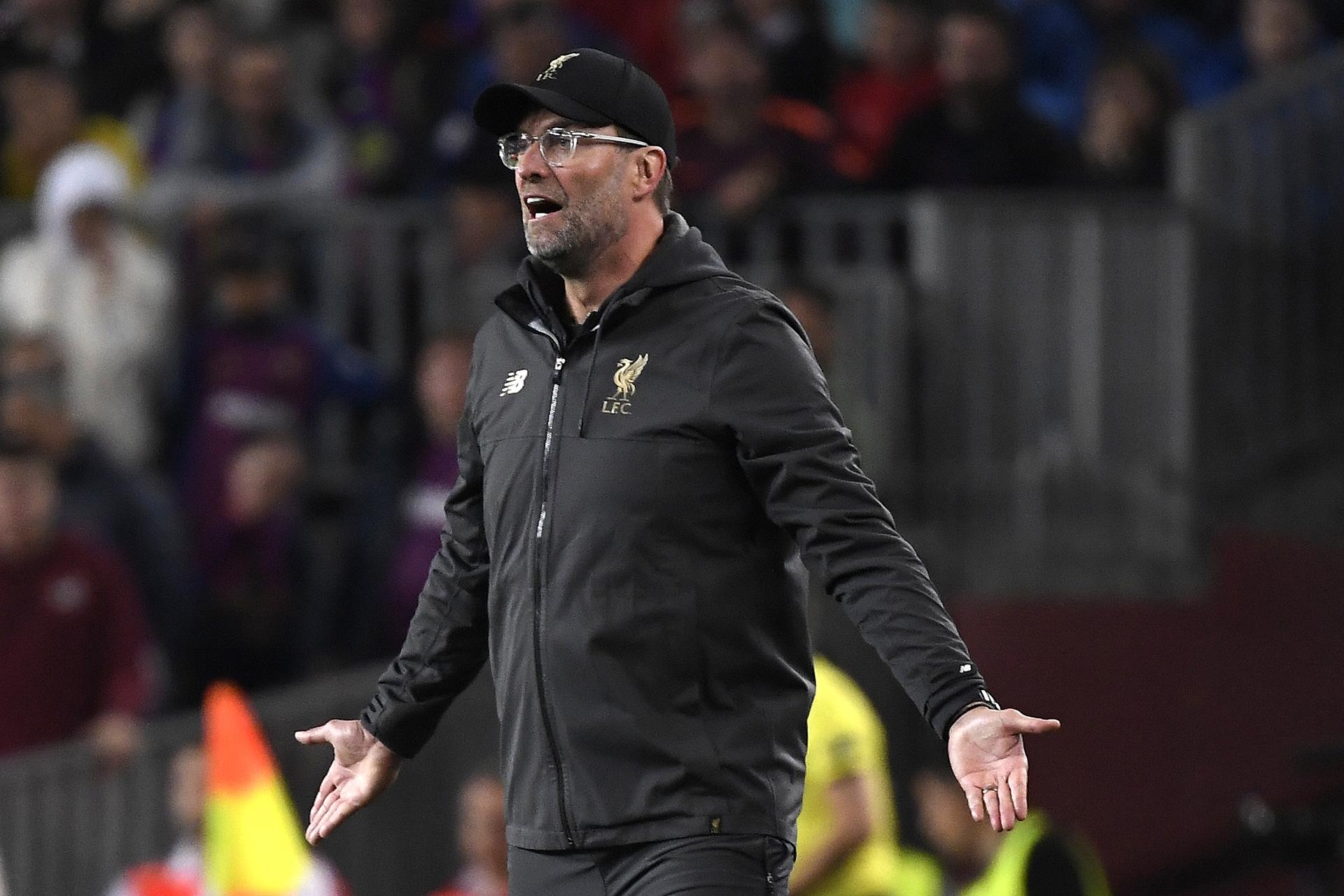 Jurgen Klopp se lamentó por la caída de su equipo en el Camp Nou (AFP)