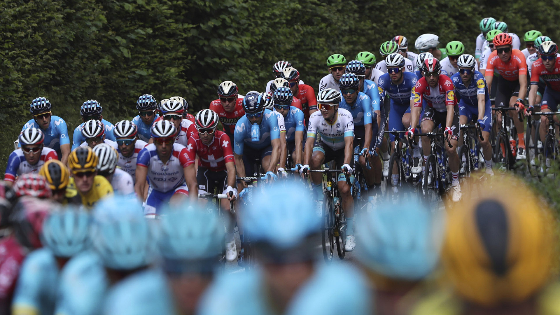 The pack rides during the third stage of the Tour de France cycling race over 215 kilometers (133,6 miles) with start in Binche and finish in Epernay, Monday, July 8, 2019. (AP Photo/Thibault Camus)