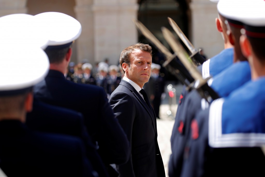 "French President Emmanuel Macron attends a ""prise d'armes"" military ceremony at the Invalides in Paris, France, July 8, 2019. REUTERS/Charles Platiau/Pool"