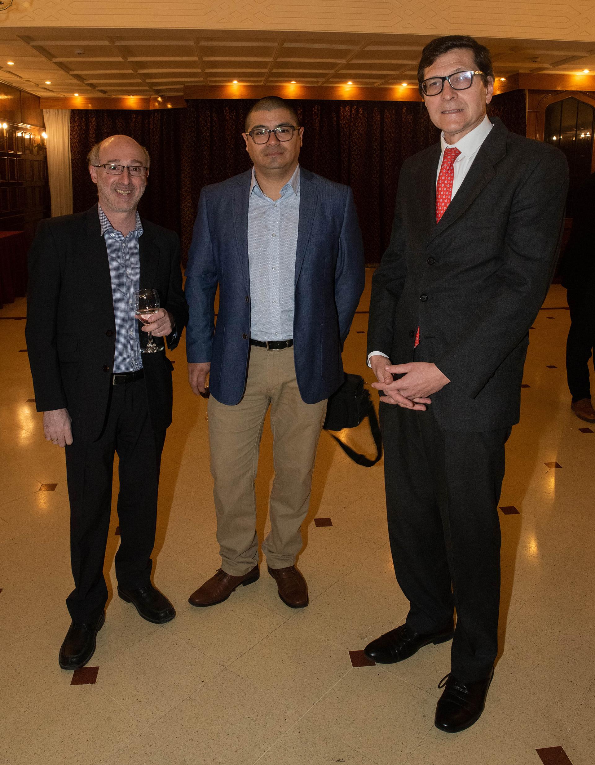 Alejandro Alfie, periodista de Clarín; Francisco Muñoz (Opi Santa Cruz); Fernando Ruiz, profesor de la Universidad Austral