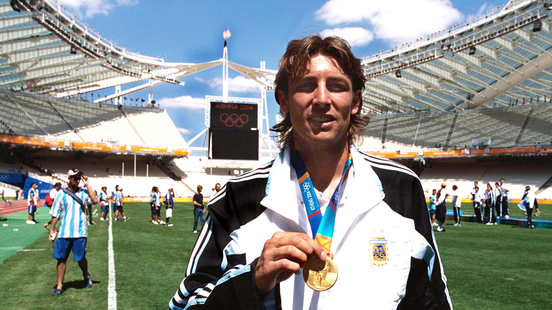 Mandatory Credit: Photo by Colorsport/Shutterstock (7435973aq) Gabriel Heinze (Argentina) who has recently signed for Manchester United celebrates with his gold Medal in front of the Olympic Flame Mens Football Final Argentina v Paraguay 28/8/2004 Athens Olympics 2004 Athens Olympics - 28 Aug 2004