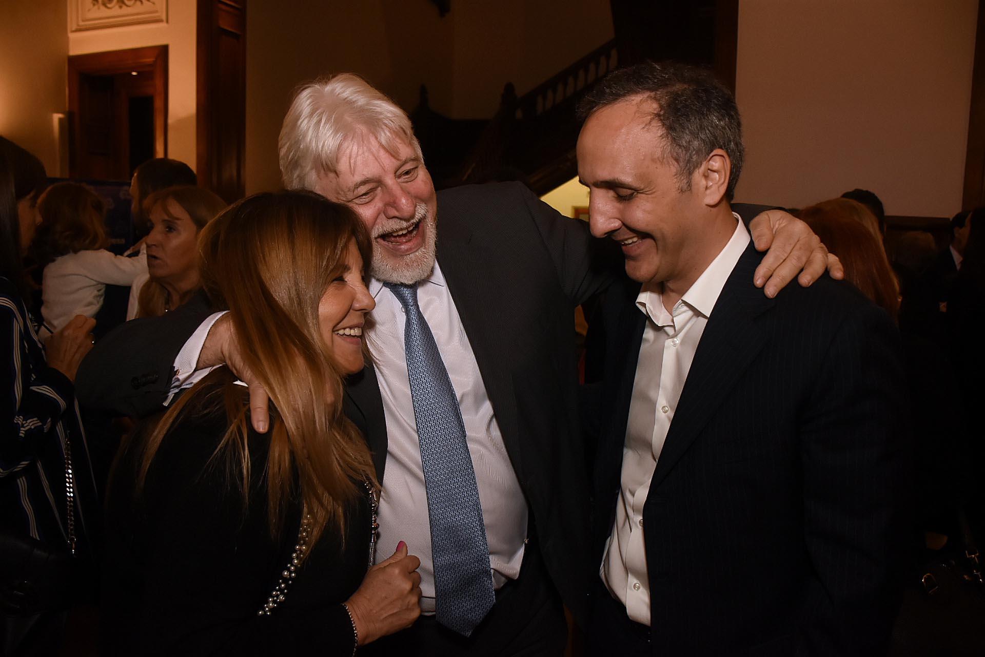Mirita del Valle, directora de Sistema Reid, Adrián Werthein y Marcos Bulgheroni