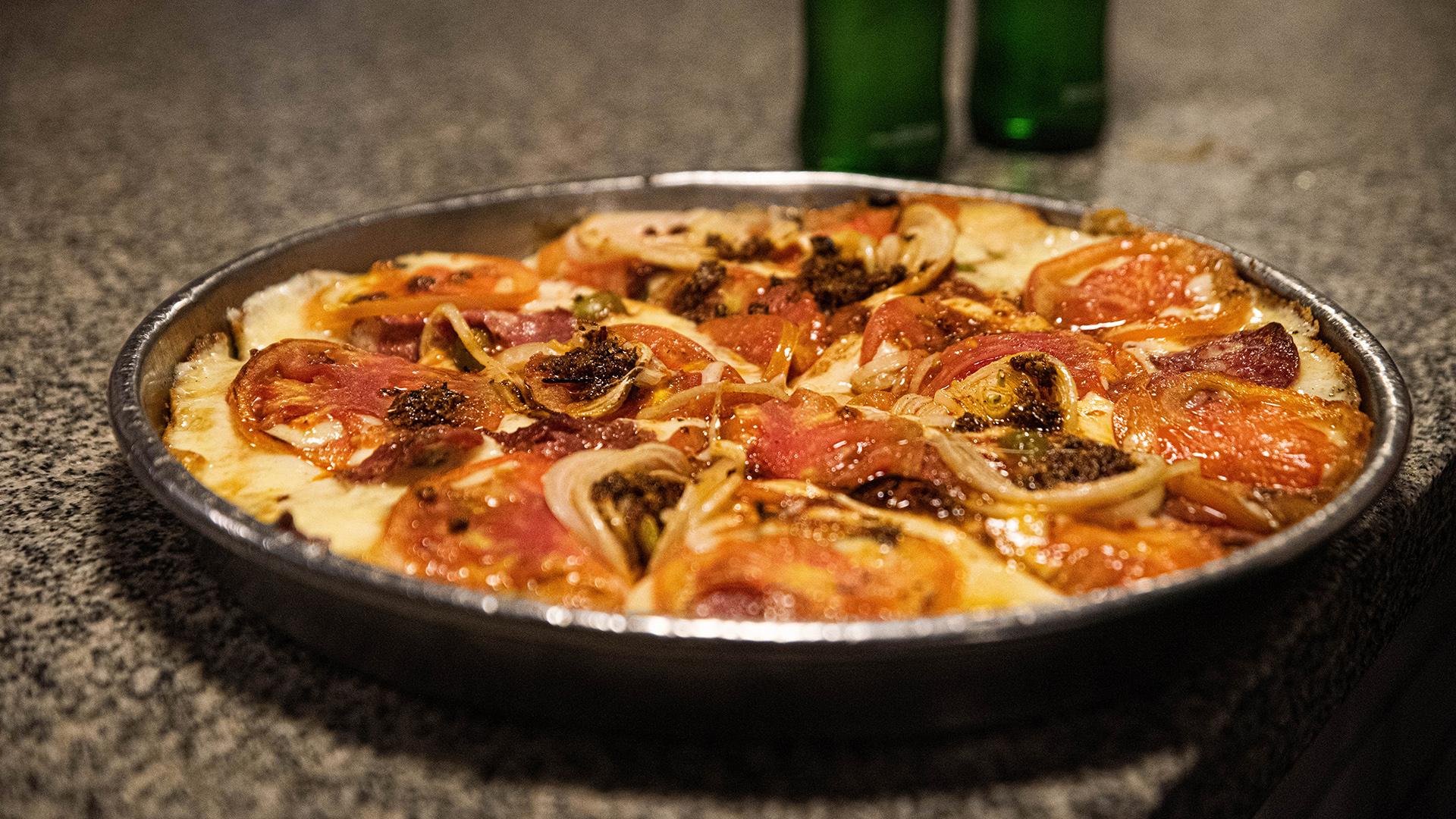 Pizza al molde, así sirven las pizzas en Banchero desde1932