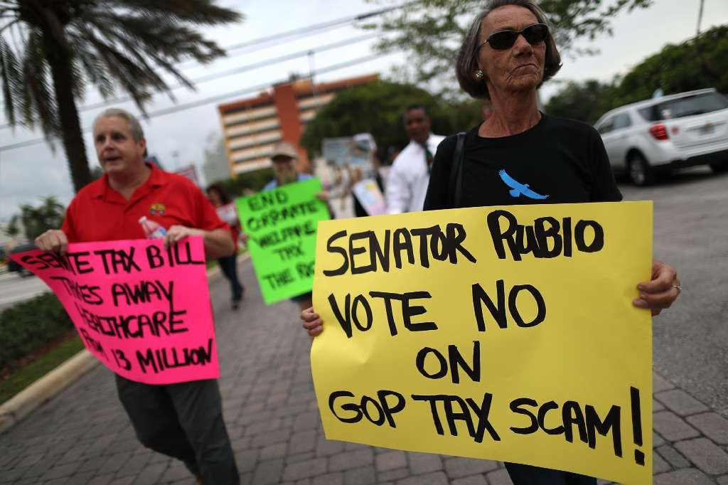 Protesters in front of Rubio's office in Doral on Sunday. [Joe Raedle/Getty Images]