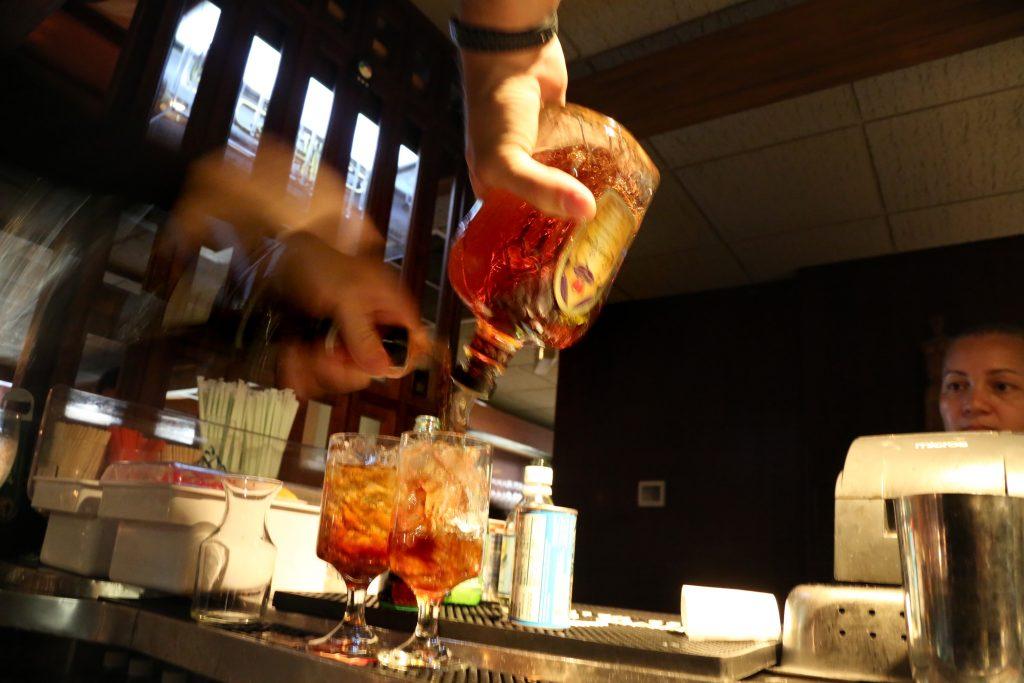 Bartender Matthew Mescato, of Tarpon Springs, makes a Manhattan for a customer at Bob Heilman's Beachcomber. [Douglas R. Clifford | Tampa Bay Times]