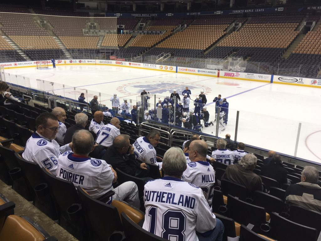 Fathers of Lightning players watch the game-day skate Monday in Toronto. [Tampa Bay Lightning]