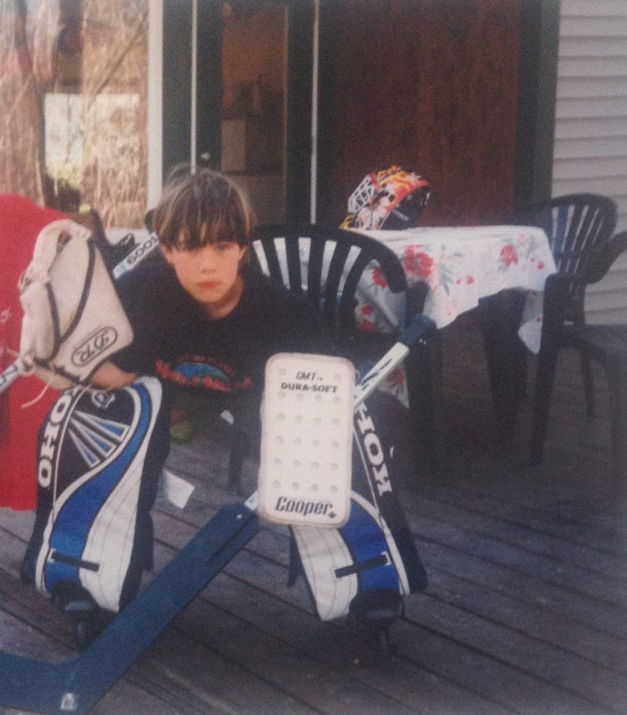 Louis Domingue got started in hockey late, around 7 or 8, and here he is showing off some of his new gear outside his family's home. [Courtesy of Charles Domingue]