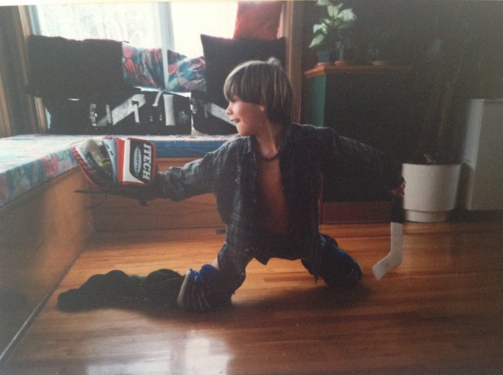 Louis Domingue, then 7 or 8, stretches out in the living room of his family's home outside of Montreal. [Courtesy of Charles Domingue]