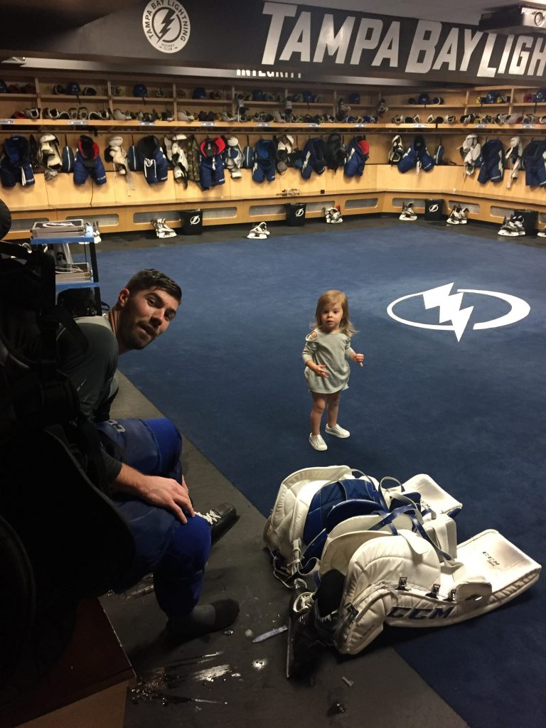 Louis Domingue hangs with his daughter Mila, 2, in the team's dressing room after practice a couple weeks ago. [Courtesy of Charles Domingue]