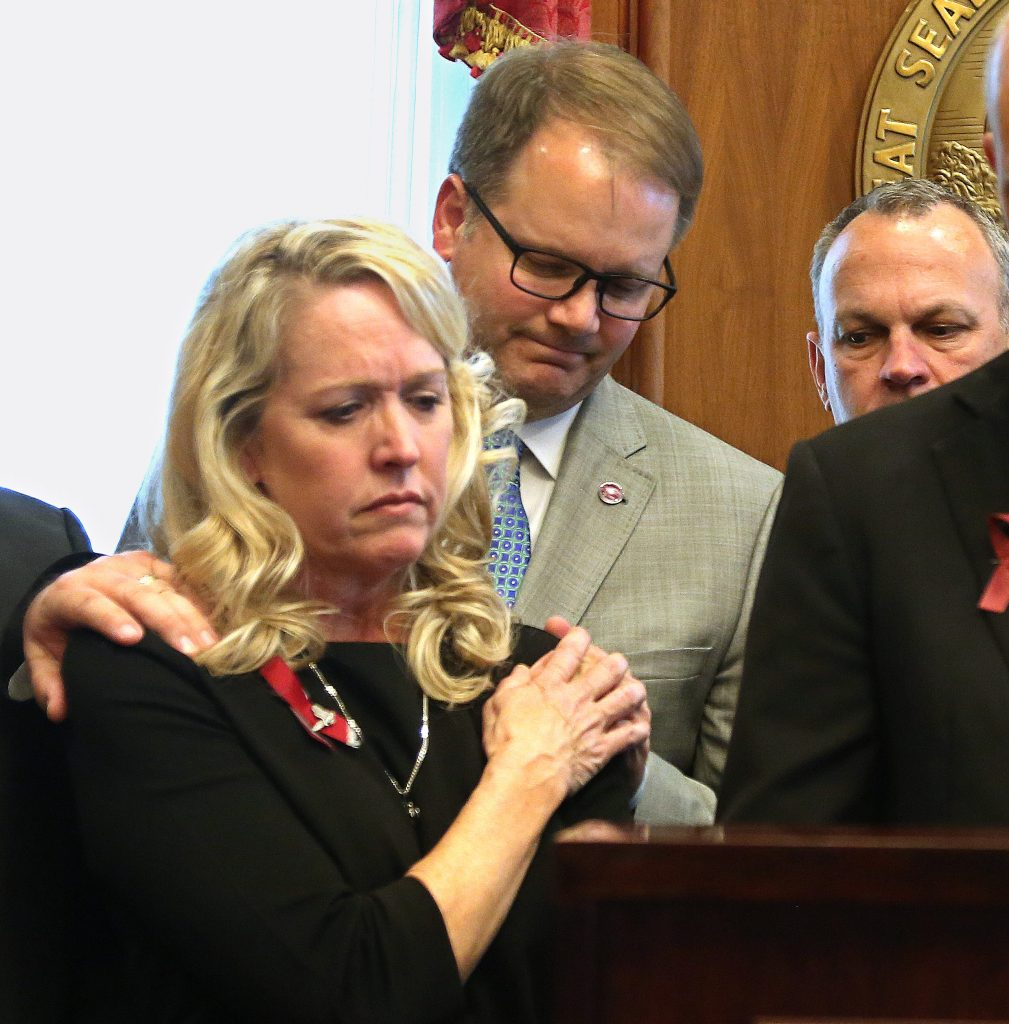 Marjory Stoneman Douglas High School parent Gena Hoyer, front is consoled by parent Ryan Petty during a gun and school safety bill signing in the Florida Capitol by Gov. Rick Scott on Friday, March 9, 2018. Both lost daughters in the shooting. [SCOTT KEELER | Times]