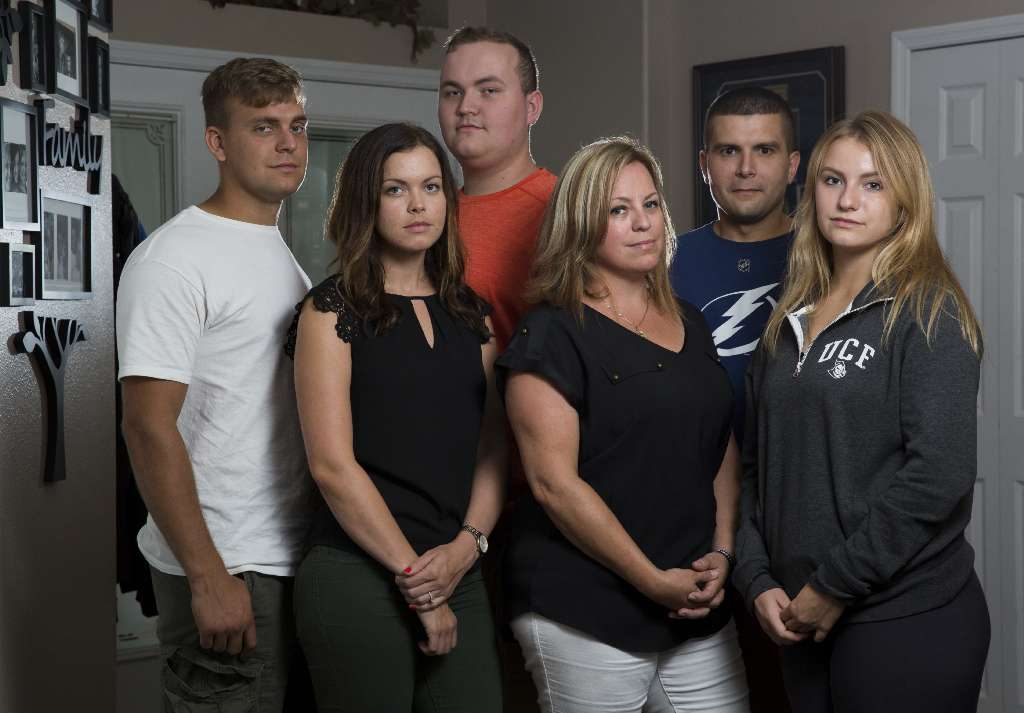 Andrew, 26, Holly, 27, Brandon, 18, Teresa, Charlie, 28, and Aleena, 17, posed for a portrait at the Kondek family home on July 14, 2017, in Spring Hill. Their father, Tarpon Springs police Officer Charles Kondek, was killed in the line of duty on Dec. 21, 2014. [MONICA HERNDON | Times]