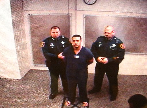 Marco Parilla, Jr., center, makes his first court appearance on Dec. 22, 2014. He is accused of killing Tarpon Springs Police officer Charles Kondek the day before. [SCOTT KEELER | Times]