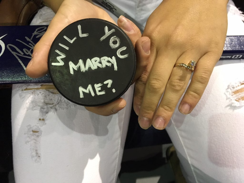"""Jeremy Joniak proposed with a puck, which had, """"Will you Marry Me"""" written in white on it. [JOE SMITH 