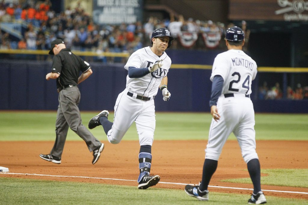 Evan Longoria (3) high-fives Rays third-base coach Charlie Montoyo (24) on his way to home plate after hitting a home run in the seventh inning. [EVE EDELHEIT | Times]
