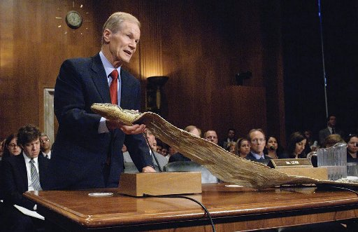 Nelson during a Wednesday, July 8, 2009 hearing on Capitol Hill, holding the skin of a 16-foot-long, 150 pound Burmese Python captured along a Miami-Dade County canal. [U.S. Senate]