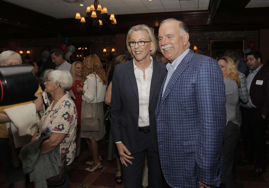 Former Tampa Police Chief Jane Castor takes a photo with Columbia Restaurant owner and supporter Richard Gonzmart as she rolled out her mayoral campaign at his Ybor City restaurant on Thursday. [OCTAVIO JONES | Times]