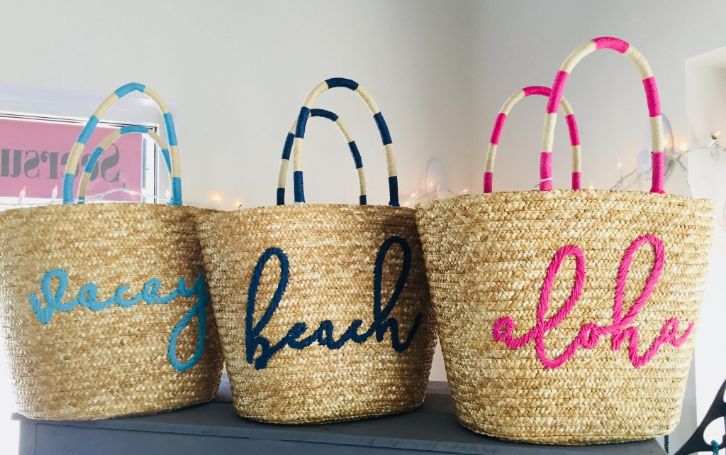 These cute straw bags are available at Seersucker Sassy Boutique, who are participating in the Downtown Safety Harbor Sidewalk Sale. [Photo by Jamie Prince]