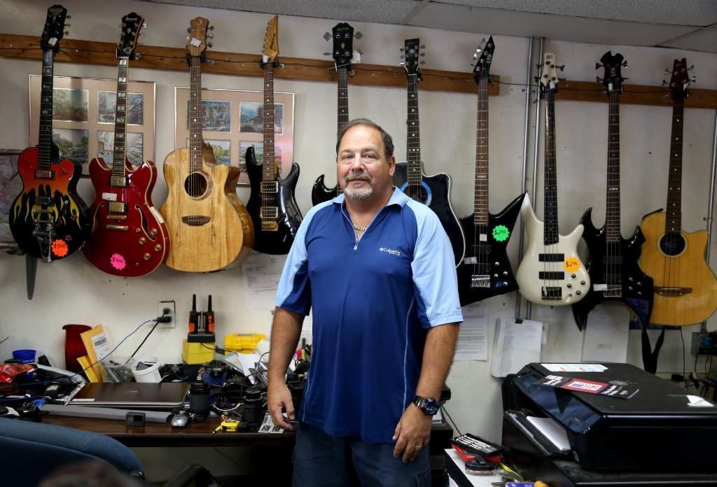 Doug Taylor, 55, of New Port Richey, discusses Trump at mid term on Wednesday at his business, Executive Jewelry and Loan, in New Port Richey. [DOUGLAS R. CLIFFORD   Tampa Bay Times]