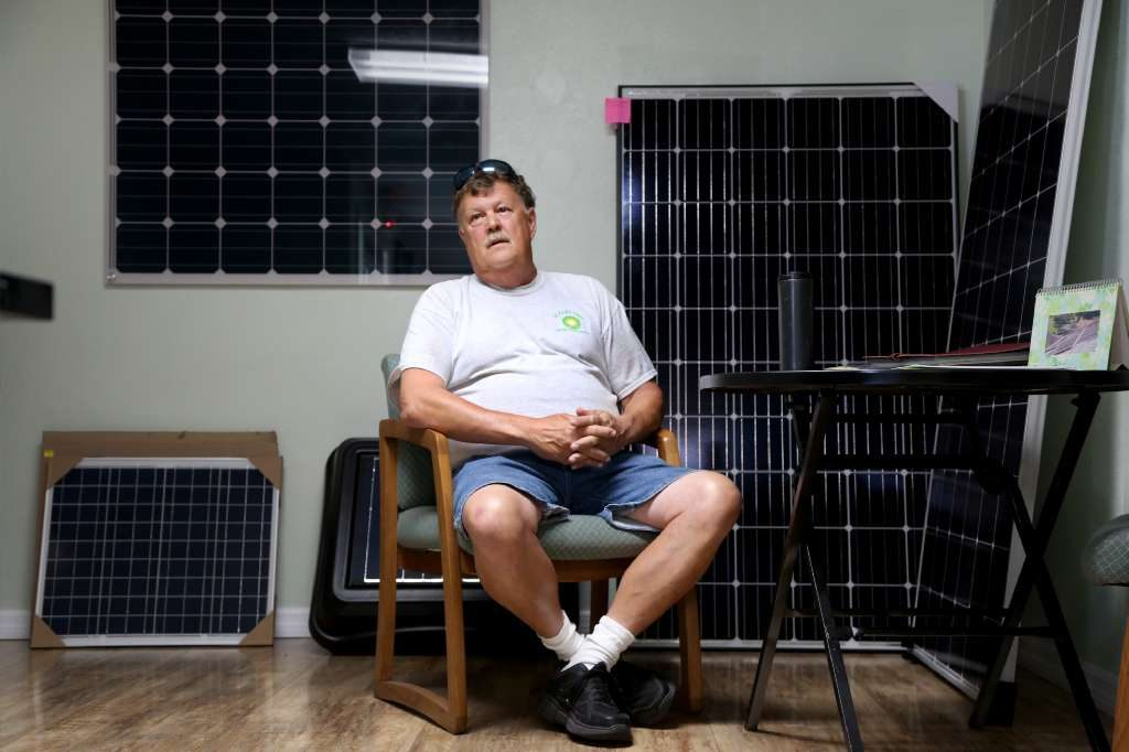 Joe Combs, 61, discusses Trump at mid term on Wednesday at his business, Solar Sales and Service, in New Port Richey. [DOUGLAS CLIFFORD | Tampa Bay Times]