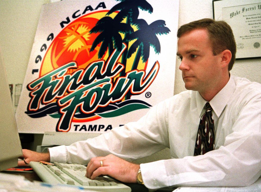 In this file photo, Michael Kelly, then director of the Tampa Bay Organizing Committee for the 1999 NCAA Final Four, works in his office near the St Pete/Clearwater airport. [Times files (1998)]