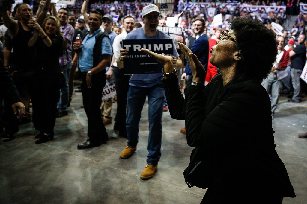 A protester blows a kiss while being kicked out of a Donald Trump rally during his presidential campaign at the University of South Florida Sun Dome in Tampa in 2016. [LOREN ELLIOTT | Times]