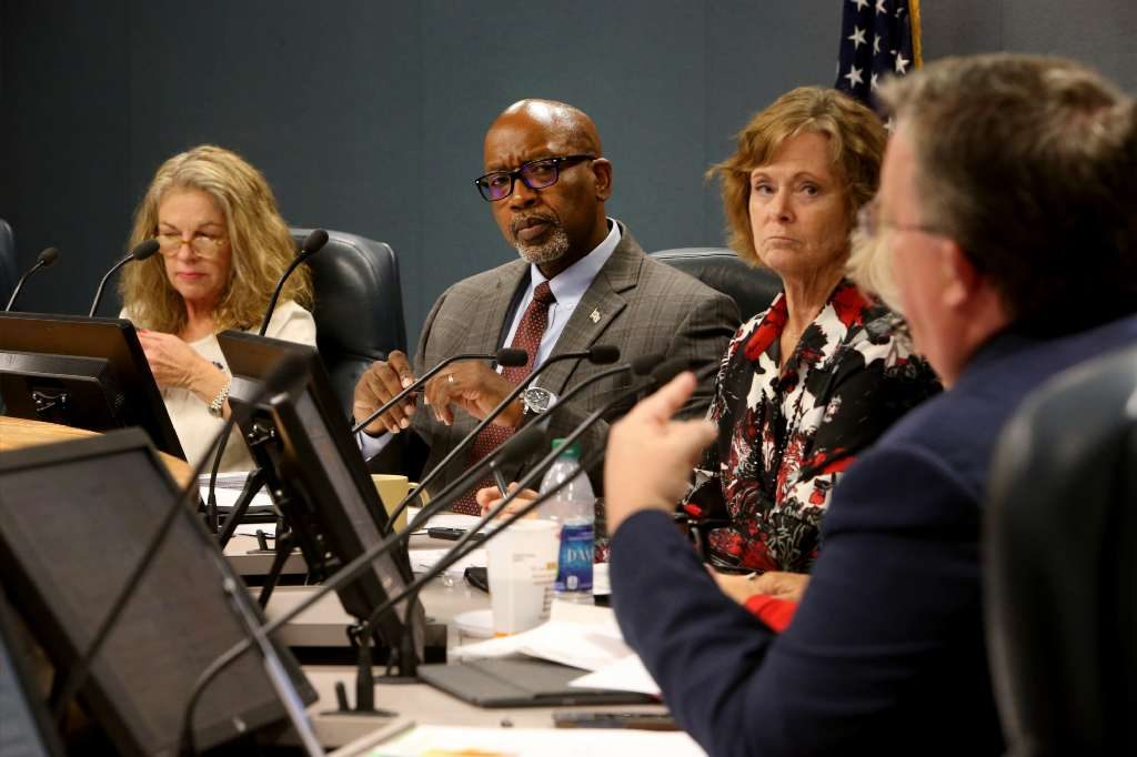Pinellas County vice chairman Karen Williams Seel, chairman Kenneth Welch and commissioners Pat Gerard and Charlie Justice attend a meeting to discuss the compensation package proposal for Barry Burton, a candidate for the next county administrator, on Aug. 29. [DOUGLAS R. CLIFFORD | Times]