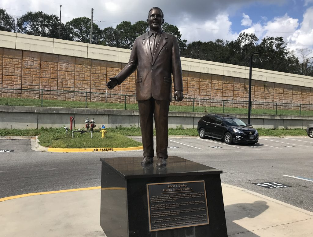 A statue of Al Dunlap stands in front of the FSU football indoor practice facility. [ MATT BAKER | TIMES ]