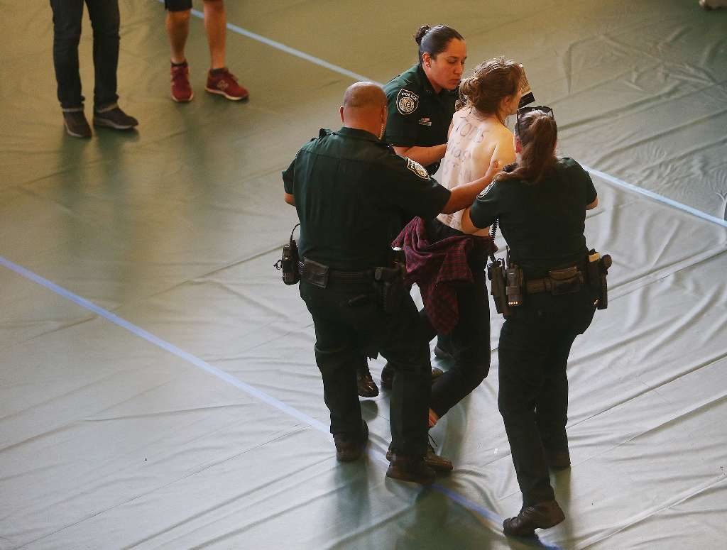Victoria Royal, 23, was arrested Wednesday at a political rally at USF after, police say, she ran through the crowd topless. [Octavio Jones | Times]