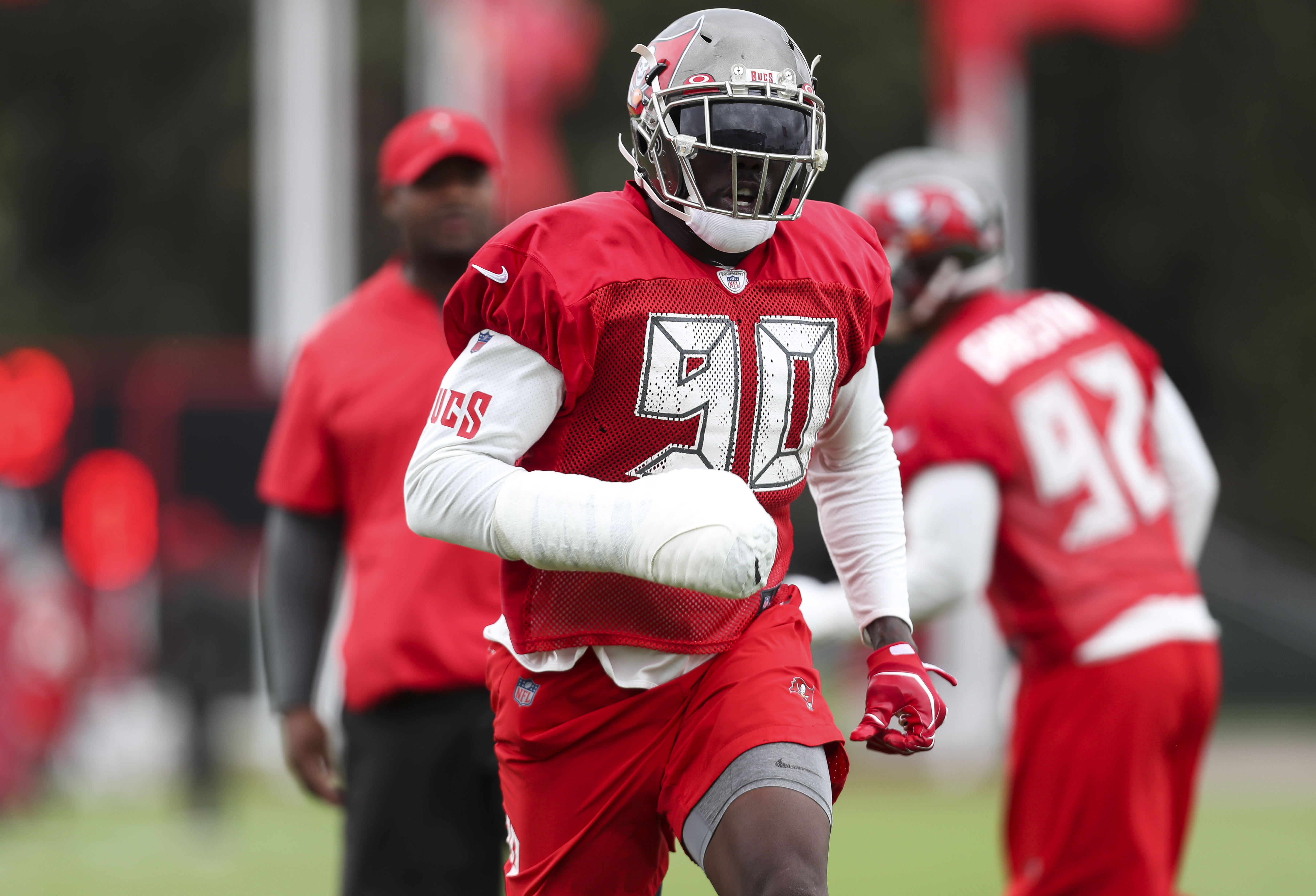 cheap for discount 641c5 0d1ad Bucs lineman Jason Pierre-Paul practices with club on right ...