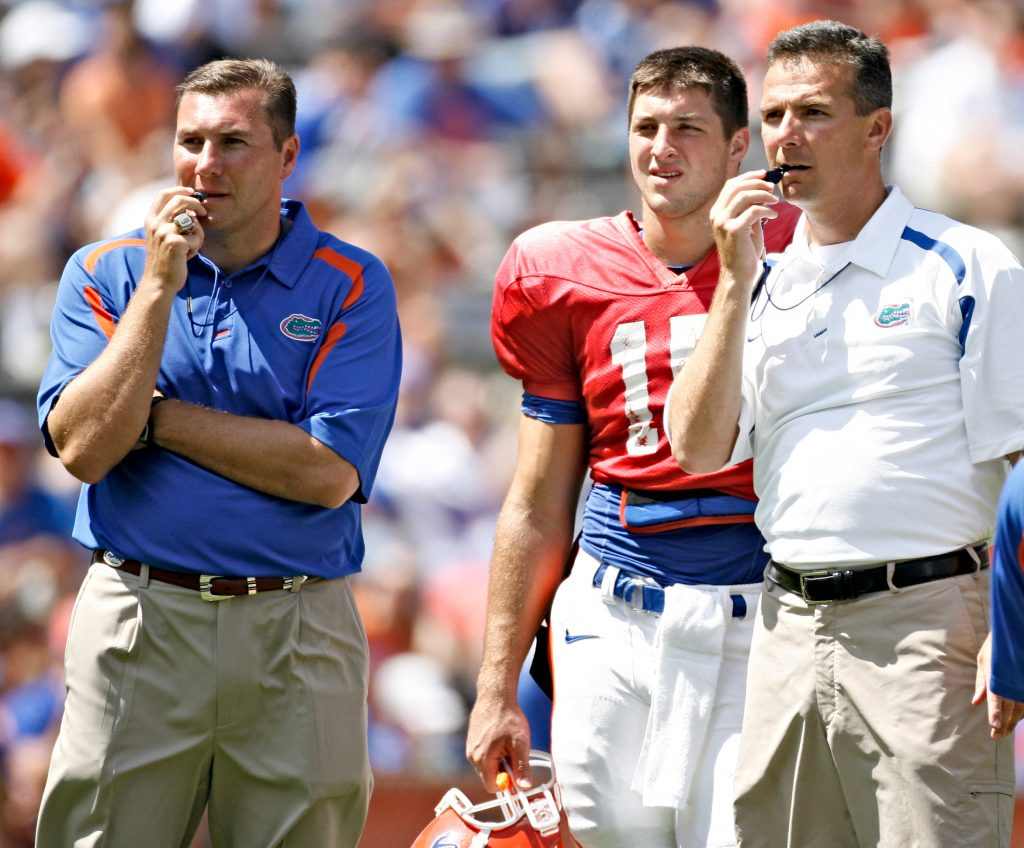 Before Dan Mullen (left) was the Florida Gators' head coach, he was an assistant there under Urban Meyer. [ TIMES FILE ]