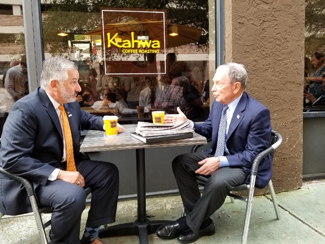 Former New York Mayor Michael Bloomberg (right) has coffee with St. Petersburg Mayor Rick Kriseman. [ADAM C. SMITH | Tampa Bay Times]