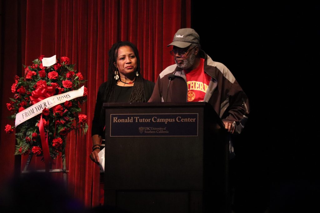 Lynette Gibson McElhaney (left) and Clarence McElhaney (right) thank the estimated 700 people at the memorial for attending. (Photo/Keyu Huang)