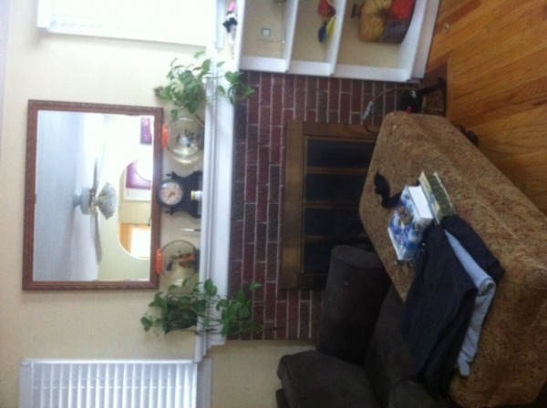 Image shows fireplace and 2 ...