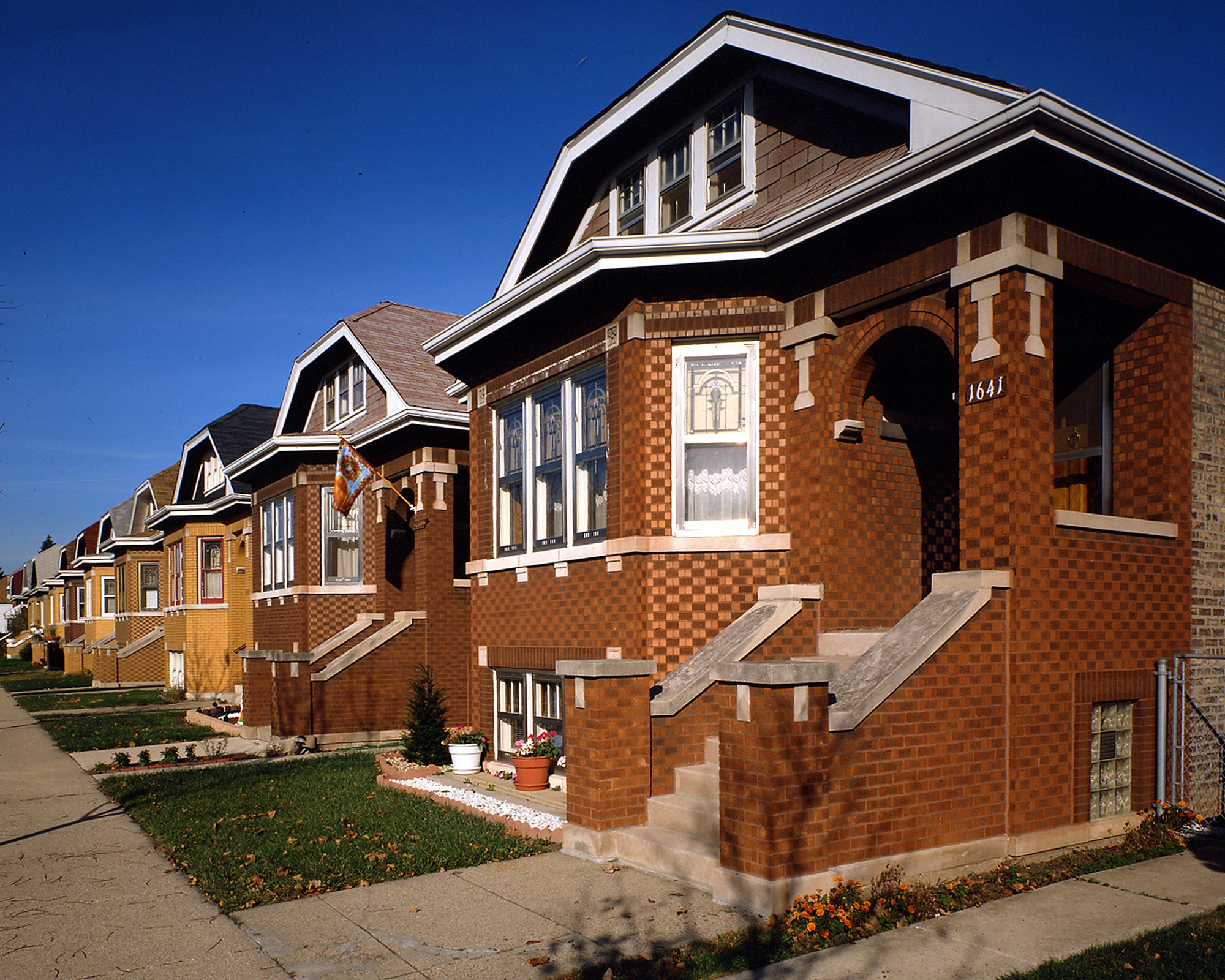 between world war i and the great depression more than 80000 bungalows were built in chicago these one and a half story homeswith detailed masonry and - Bungalow