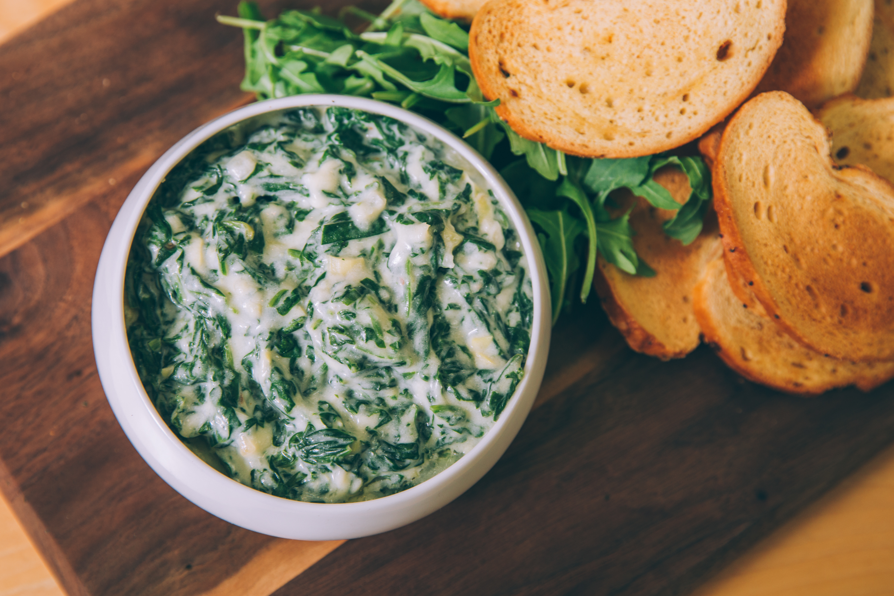 Spinach and artichoke fondue dip with toasted bread - appetizers for awards season