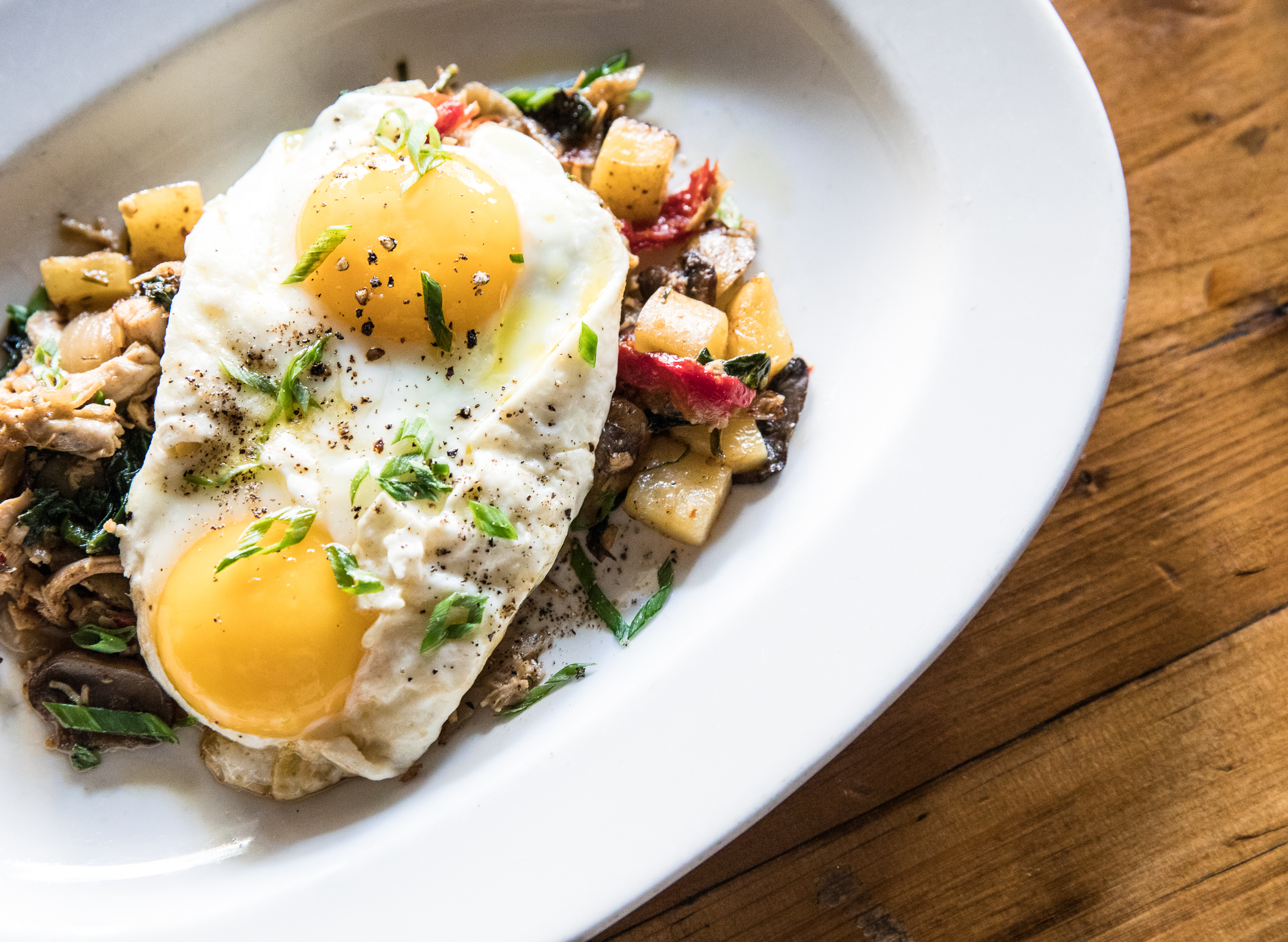 Eggs over hash from Osteria Via Stato